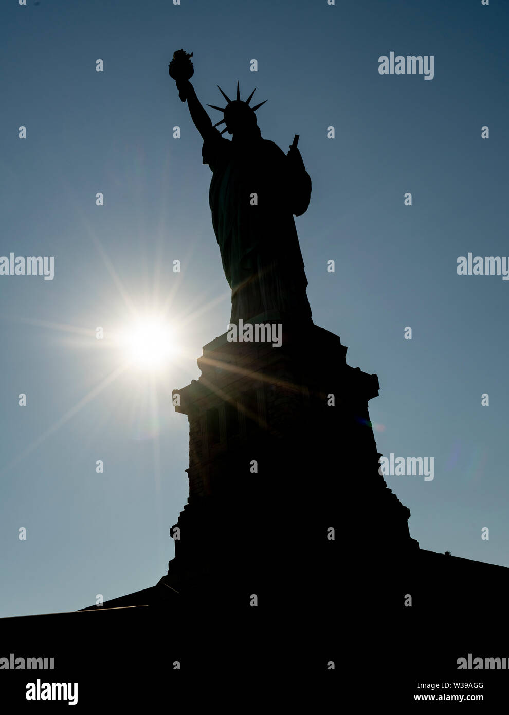 It's a cutout on blue of lady liberty in the Statue of Liberty - Stock Image