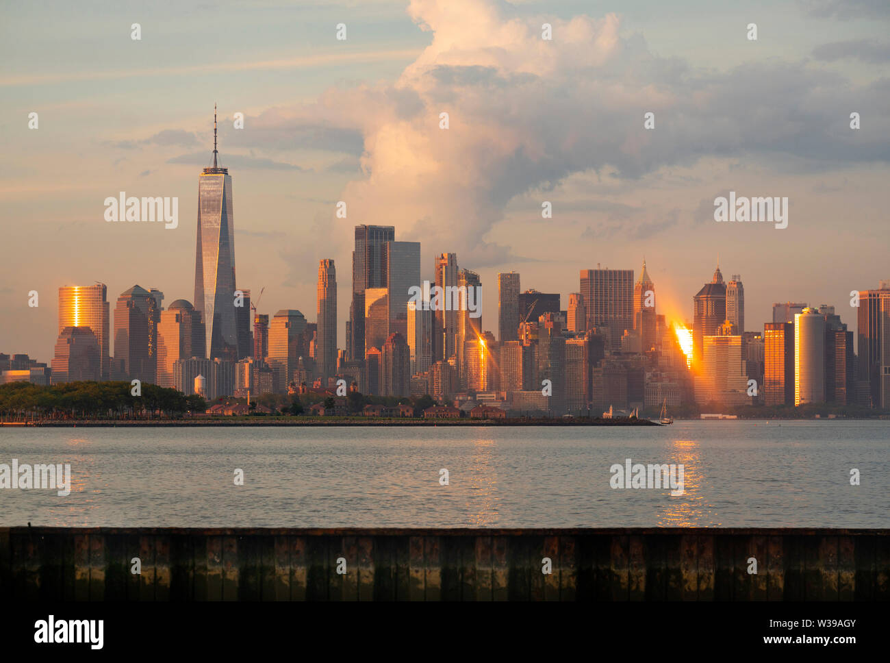 Manhattan is one of 5 Burroughs that make up New York City shown here at sunset - Stock Image