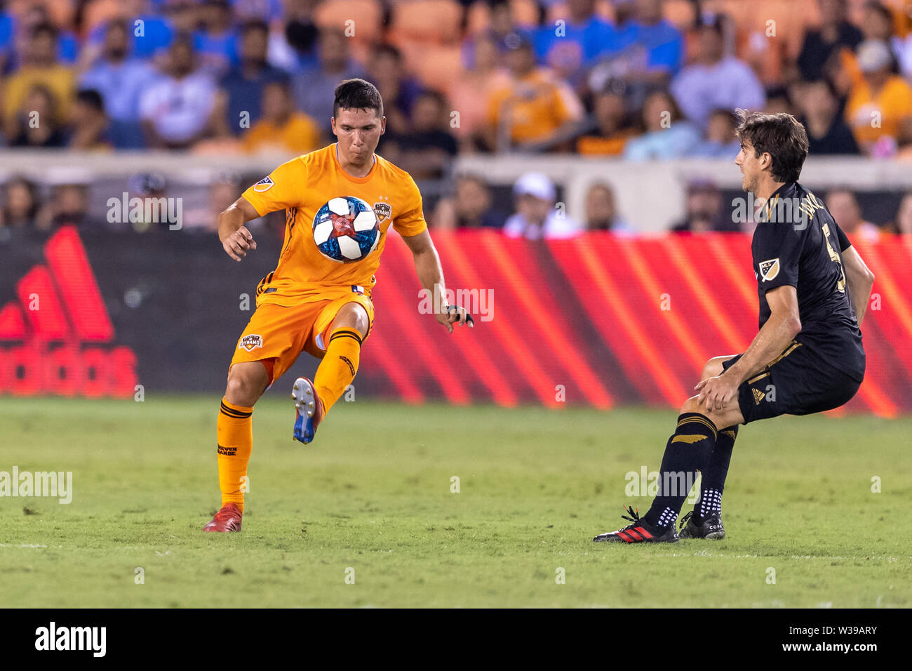 Houston, Texas, USA. 12th July, 2019. Houston Dynamo midfielder Tomas Martinez (10) looks to control the ball during a match between Los Angeles FC and Houston Dynamo at BBVA Stadium in Houston, Texas. The final LAFC wins 3-1. Maria Lysaker/CSM/Alamy Live News - Stock Image