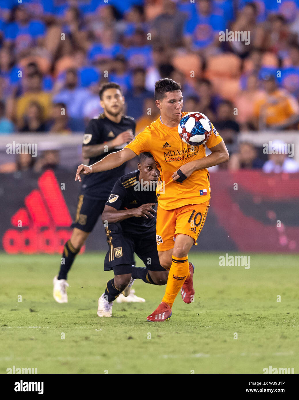 Houston, Texas, USA. 12th July, 2019. Houston Dynamo midfielder Tomas Martinez (10) looks to control the ball from Los Angeles FC forward Latif Blessing (7) during a match between Los Angeles FC and Houston Dynamo at BBVA Stadium in Houston, Texas. The final LAFC wins 3-1. Maria Lysaker/CSM/Alamy Live News - Stock Image