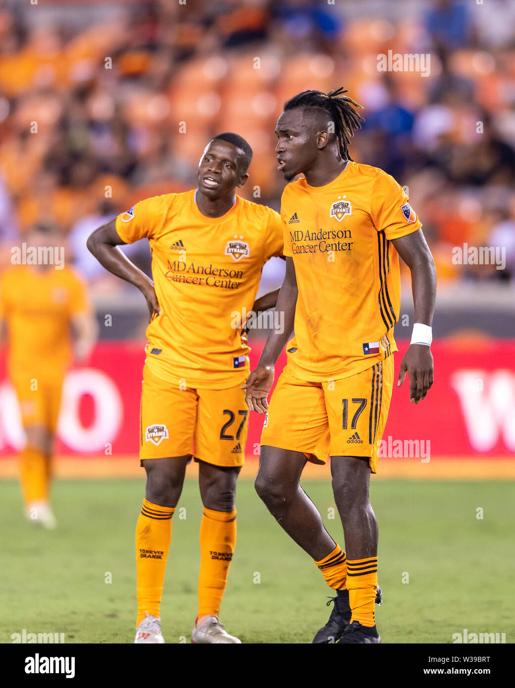 Houston, Texas, USA. 12th July, 2019. Houston Dynamo midfielder Oscar Boniek Garcia (27) and forward Alberth Elis (17) wait to clear a decision from the referee during a match between Los Angeles FC and Houston Dynamo at BBVA Stadium in Houston, Texas. The final LAFC wins 3-1. Maria Lysaker/CSM/Alamy Live News - Stock Image