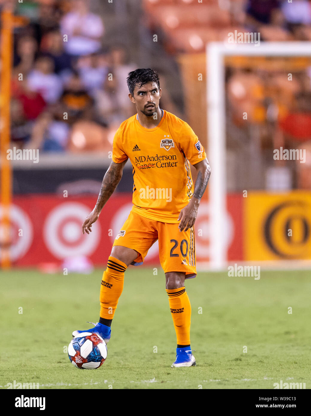 Houston, Texas, USA. 12th July, 2019. Houston Dynamo defender A.J. DeLaGarza (20) looks to send the ball during a match between Los Angeles FC and Houston Dynamo at BBVA Stadium in Houston, Texas. The final LAFC wins 3-1. Maria Lysaker/CSM/Alamy Live News - Stock Image