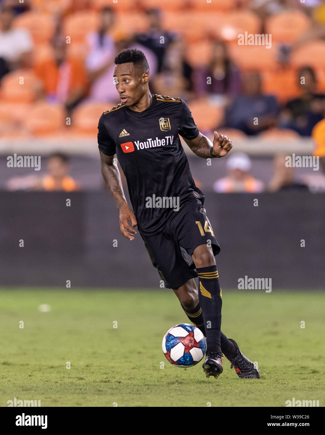 Houston, Texas, USA. 12th July, 2019. Los Angeles FC midfielder Mark-Anthony Kaye (14) during a match between Los Angeles FC and Houston Dynamo at BBVA Stadium in Houston, Texas. The final LAFC wins 3-1. Maria Lysaker/CSM/Alamy Live News - Stock Image