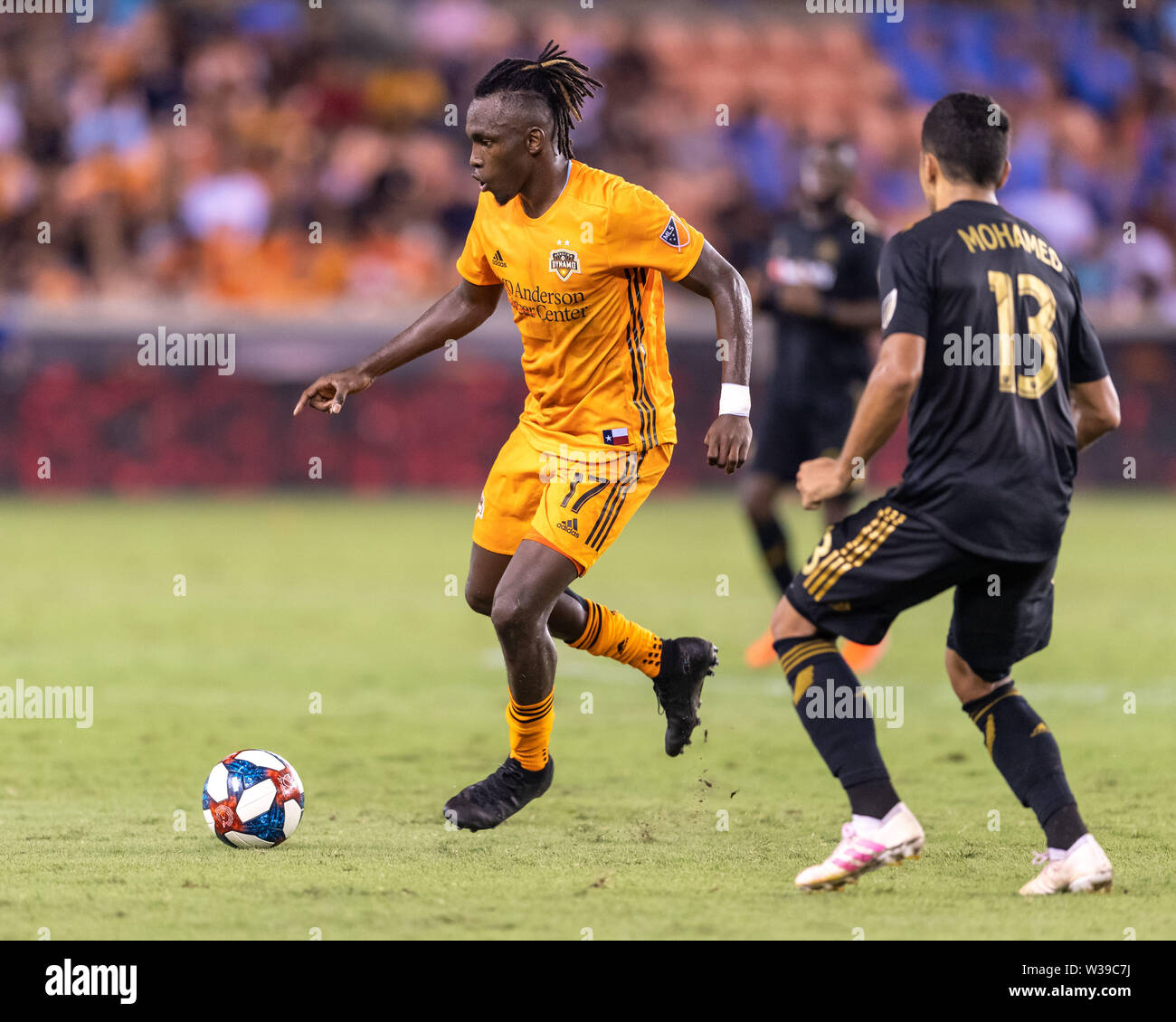 Houston, Texas, USA. 12th July, 2019. Houston Dynamo forward Alberth Elis (17) moves the ball during a match between Los Angeles FC and Houston Dynamo at BBVA Stadium in Houston, Texas. The final LAFC wins 3-1. Maria Lysaker/CSM/Alamy Live News - Stock Image