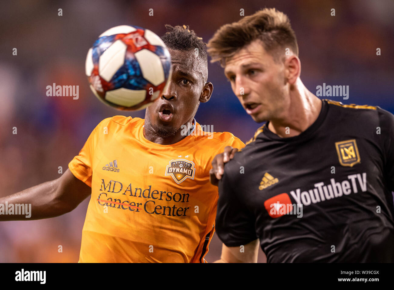 Houston, Texas, USA. 12th July, 2019. Houston Dynamo forward Alberth Elis (17) and Los Angeles FC defender Walker Zimmerman (25) chase after the ball during a match between Los Angeles FC and Houston Dynamo at BBVA Stadium in Houston, Texas. The final LAFC wins 3-1. Maria Lysaker/CSM/Alamy Live News - Stock Image