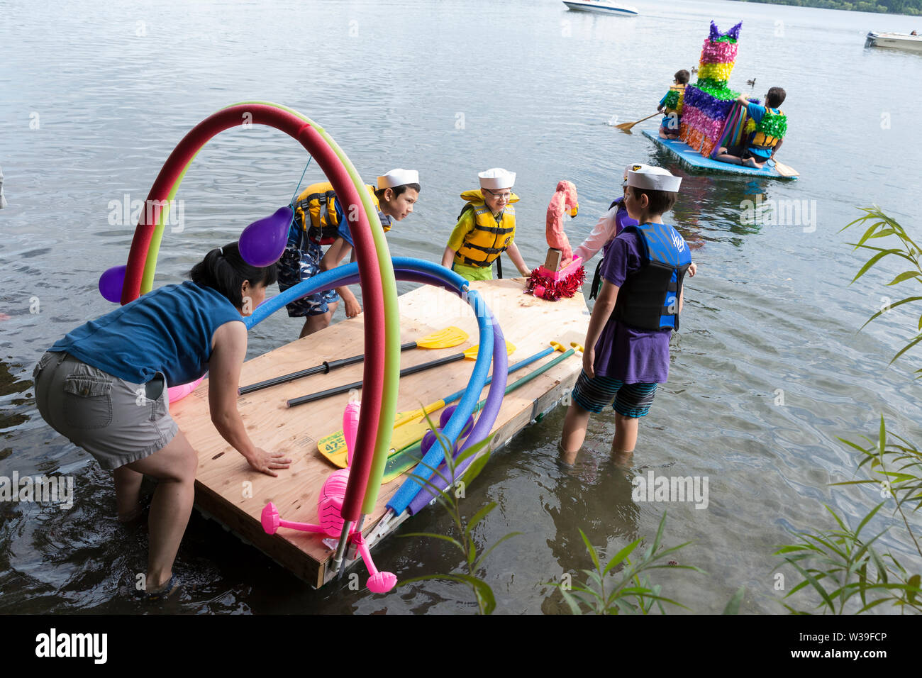 Members of the Purple Rain team launch their boat at the the