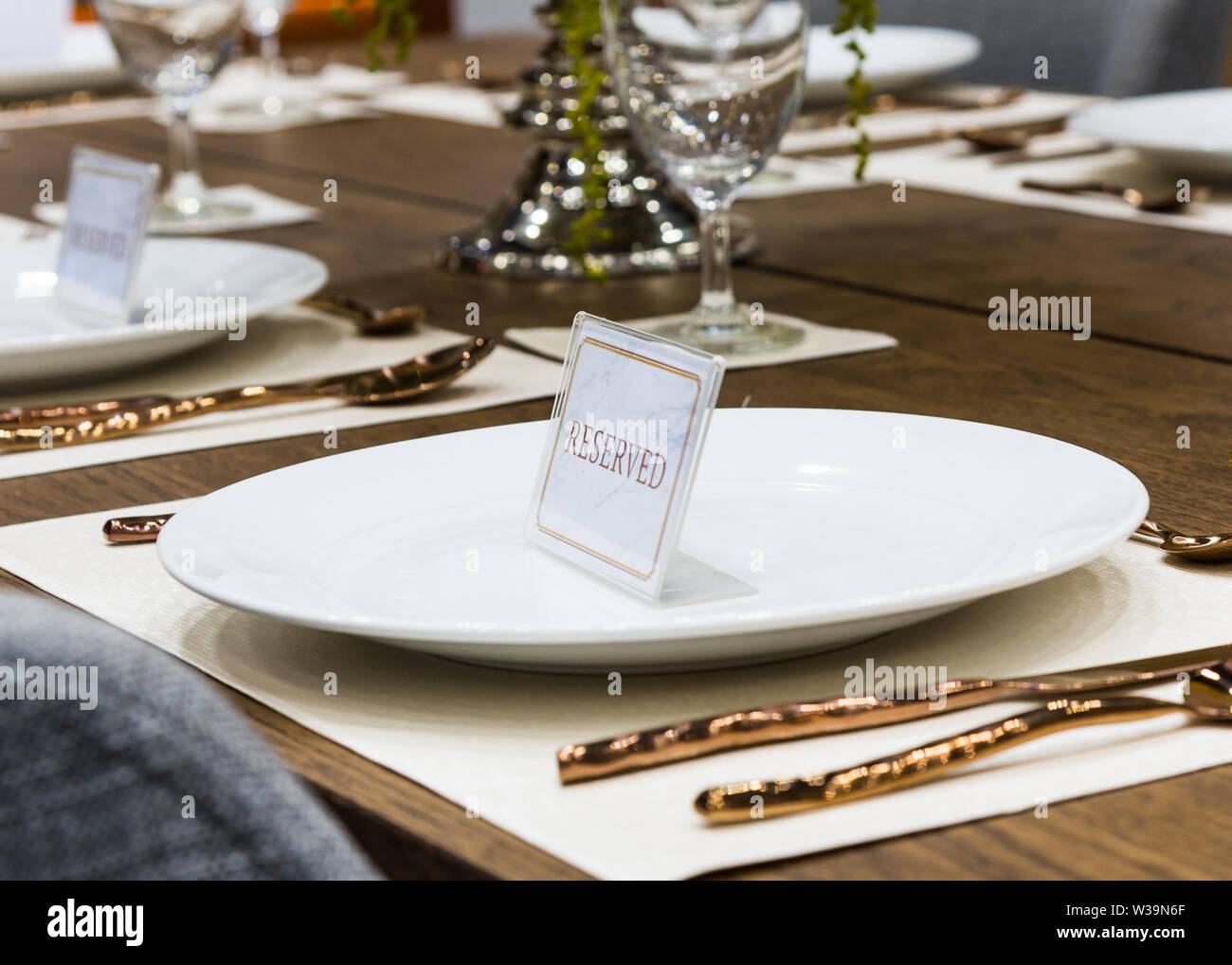 Reservation on a dinner table at the restaurant, plate reserve - Stock Image