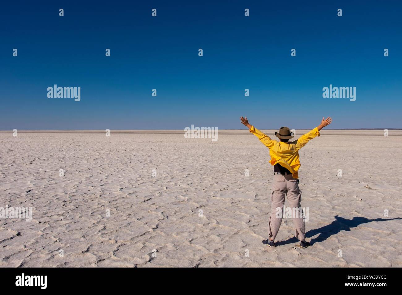 Woman enjoying dry salt lake of Kati Thanda-Lake Eyre in outback in northern South Australia. - Stock Image