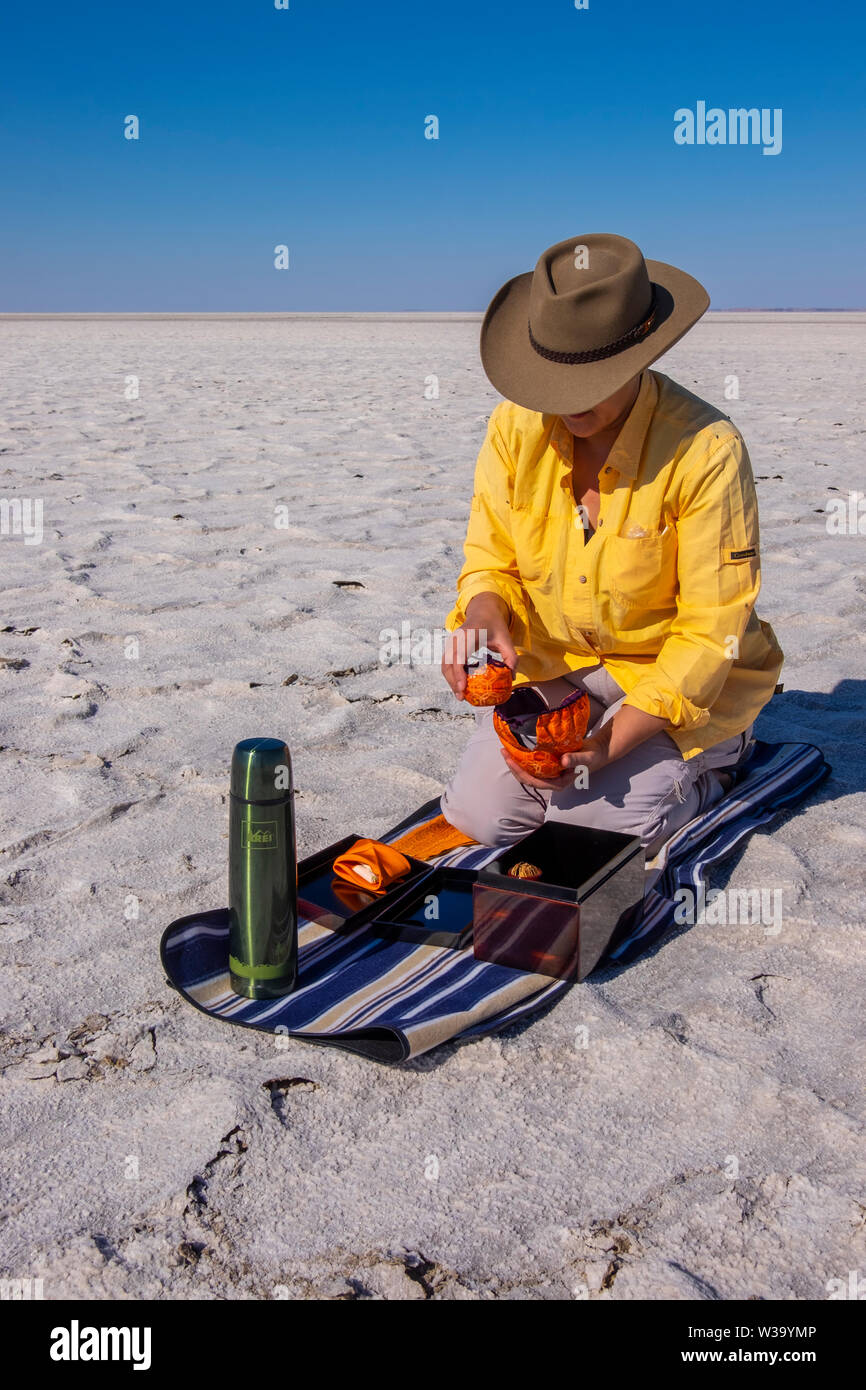 Japanese Tea Ceremony on the salt crust of Kati Thanda-Lake Eyre in outback in northern South Australia. - Stock Image