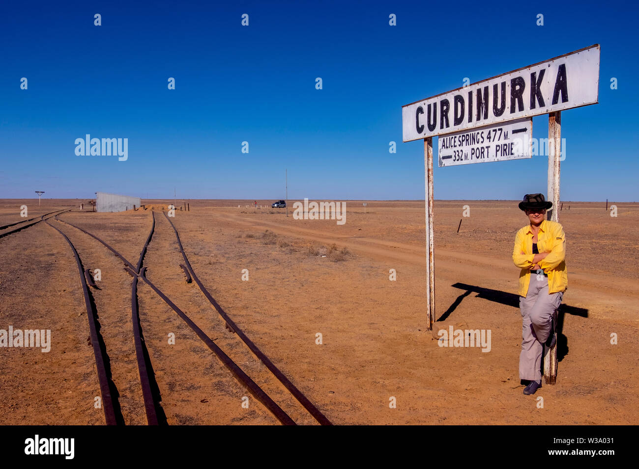 Woman at Curdimurka Terminal along Oodnadatta Track, Andamooka south from Kati Thanda-Lake Eyre in outback in northern South Australia. - Stock Image