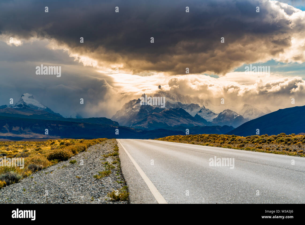 View of the road to El Chalten with Mount Fitz Roy in the mist and  rain clouds in the sky at Argentina Patagonia - Stock Image
