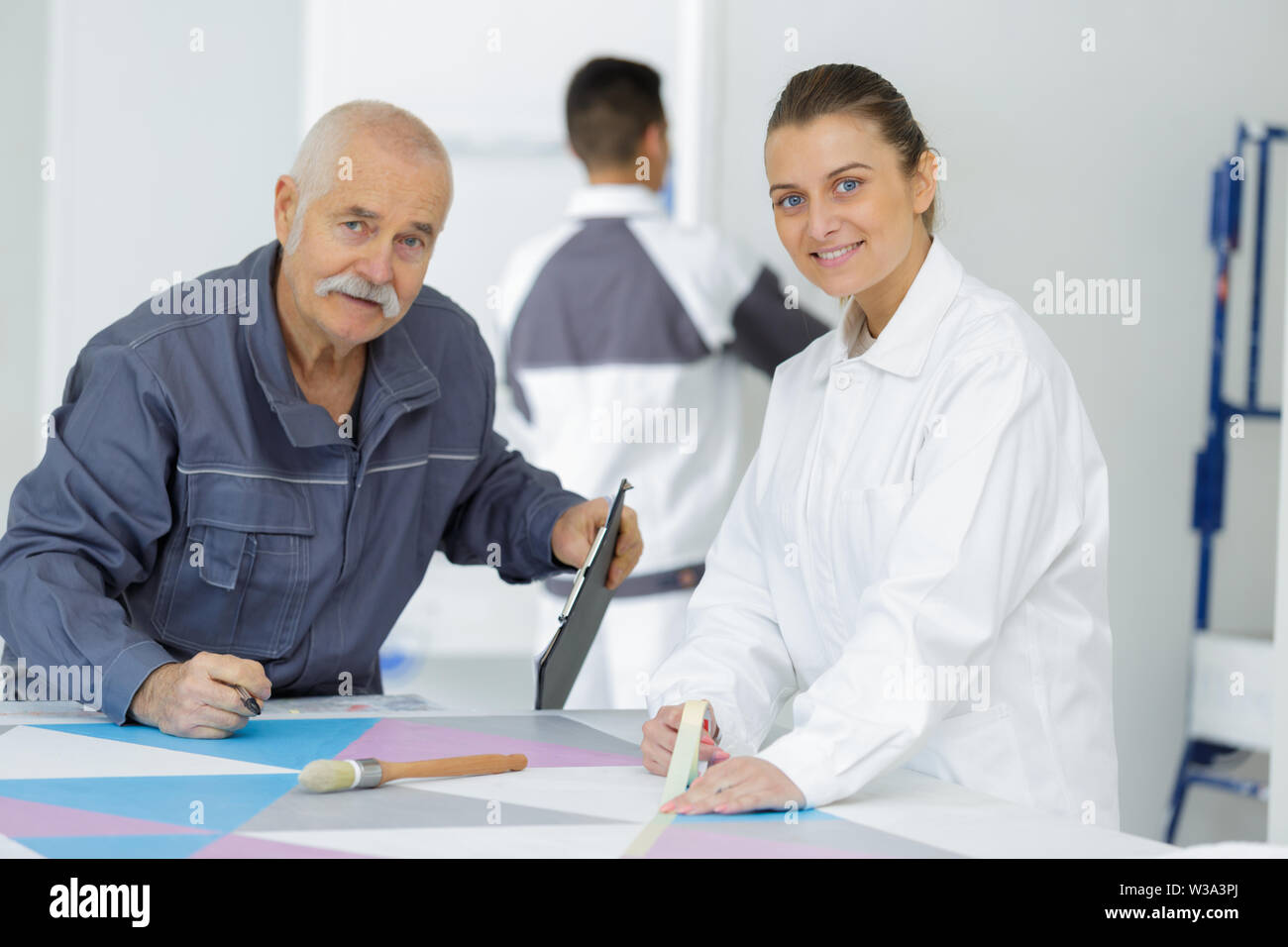 young apprentice painter in professional training - Stock Image