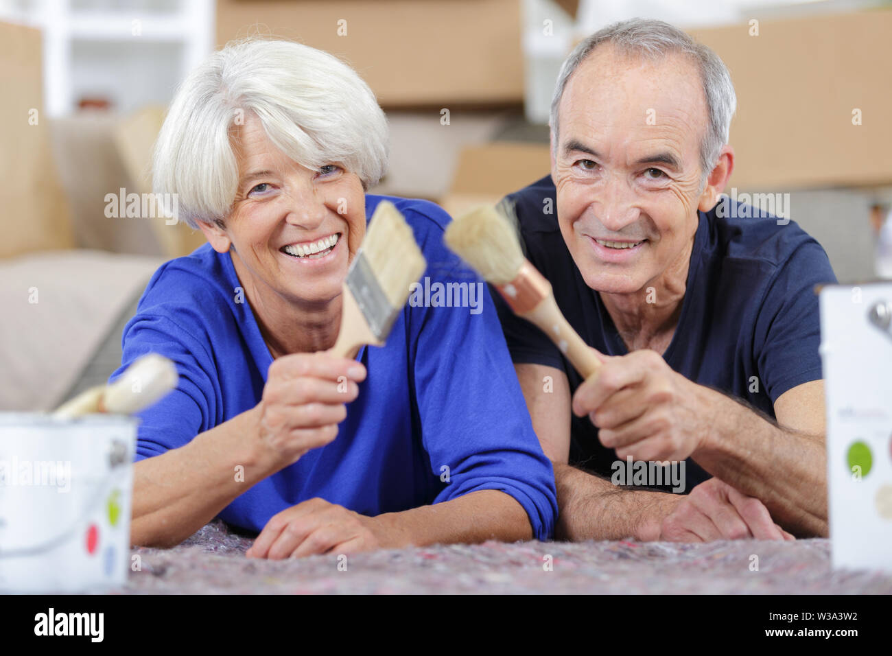 elderly couple with renovation tools - Stock Image