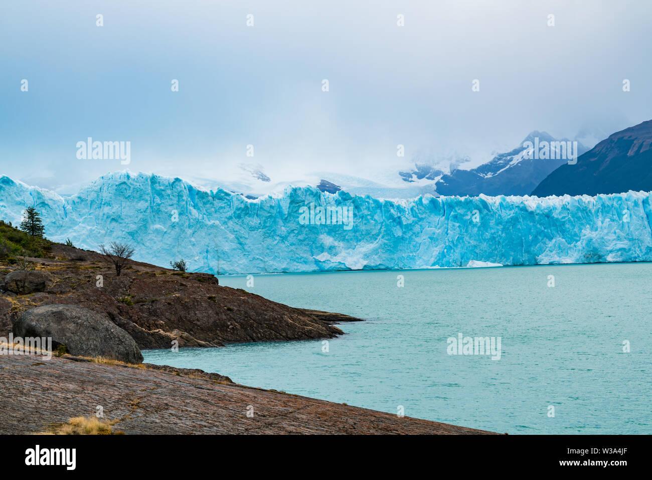 Blue iceberg of Perito Moreno Glacier and Argentina Lake at Los Glaciares National Park in Argentina Patagonia - Stock Image