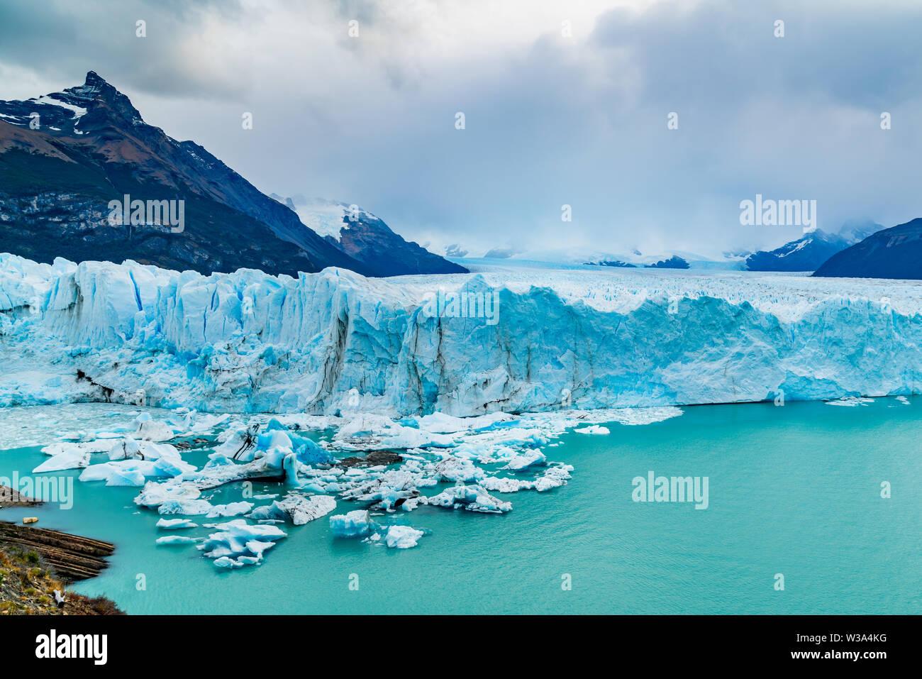 View of Perito Moreno Glacier with Iceberg floating in Argentina lake in Los Glaciares National Park Argentina Patagonia - Stock Image