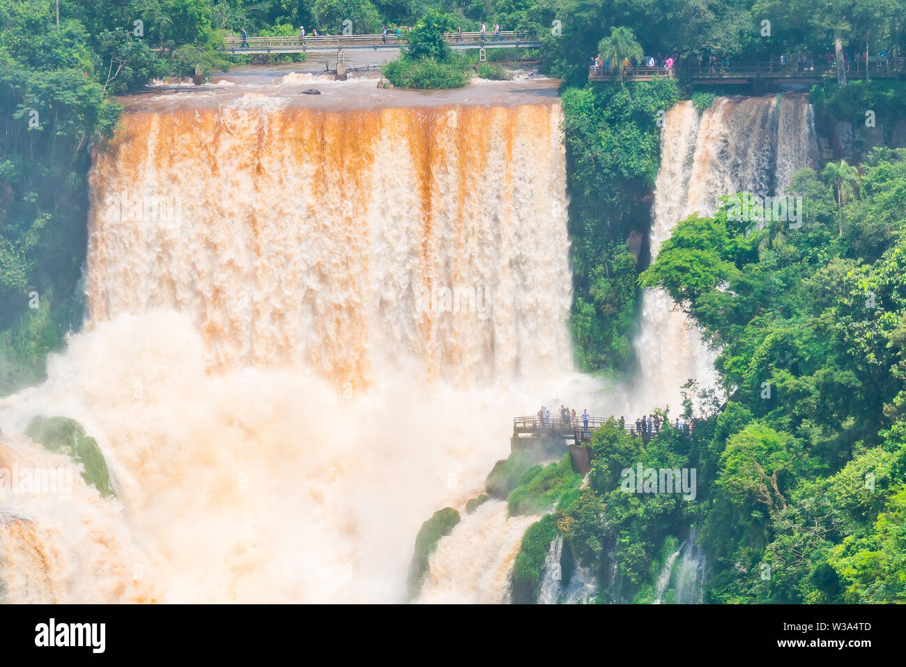 People walking on the catwalks at Iguazu Falls at the border of Brazil and Argentina - Stock Image