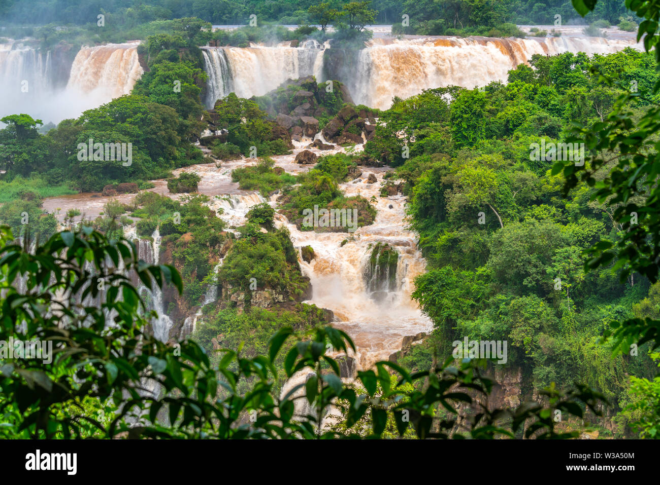 View of the famous Iguazu Falls from Brazilian side. Iguazu falls are waterfalls of the Iguazu River at the border of Argentina and Brazil - Stock Image