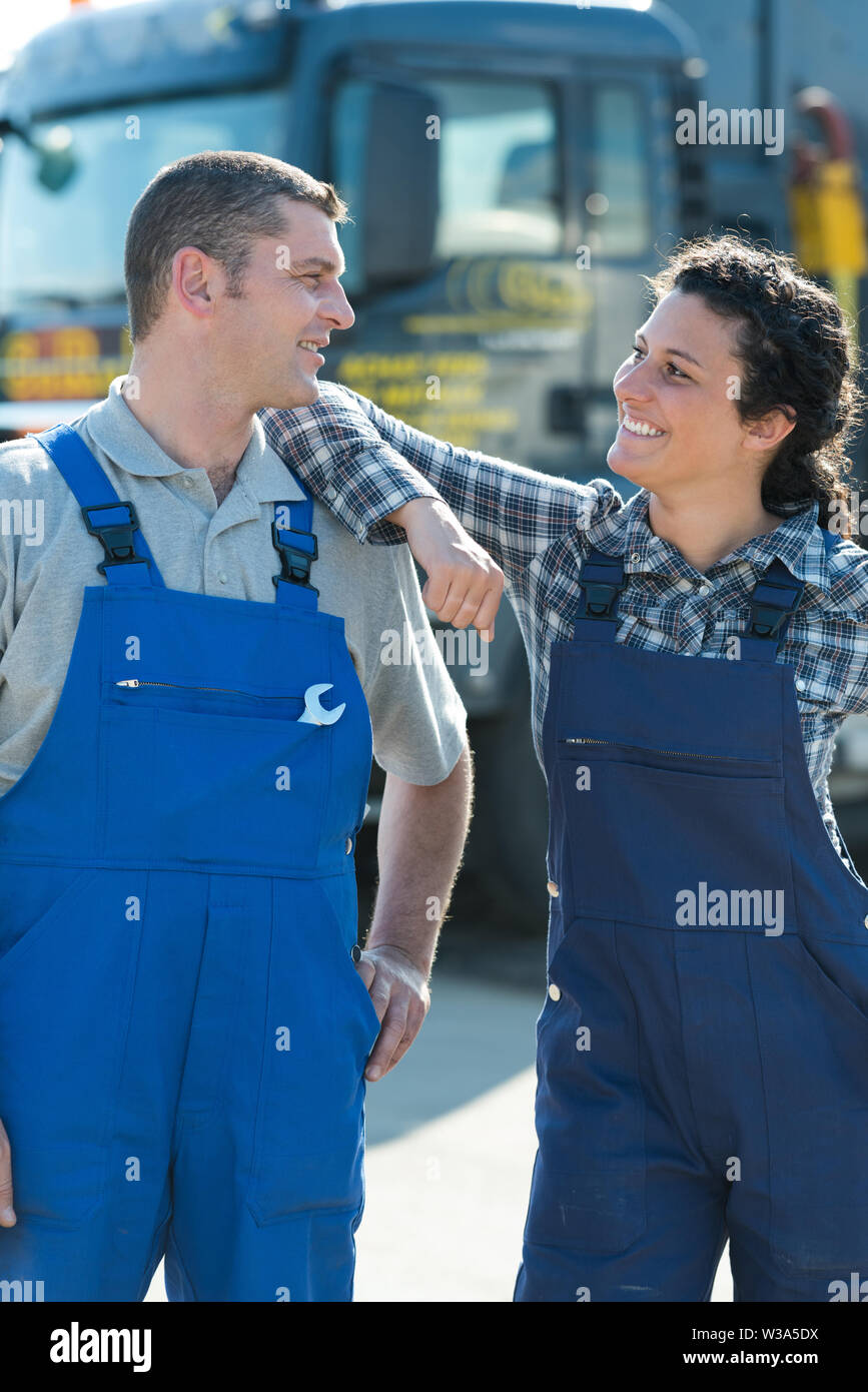 professional auto woman and man mechanic outdoors - Stock Image