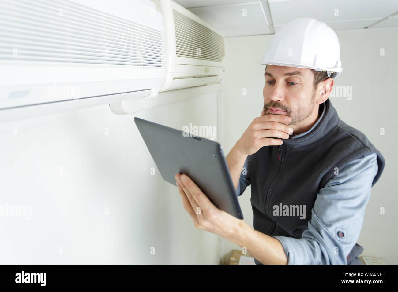 portrait of a maintenance technician - Stock Image