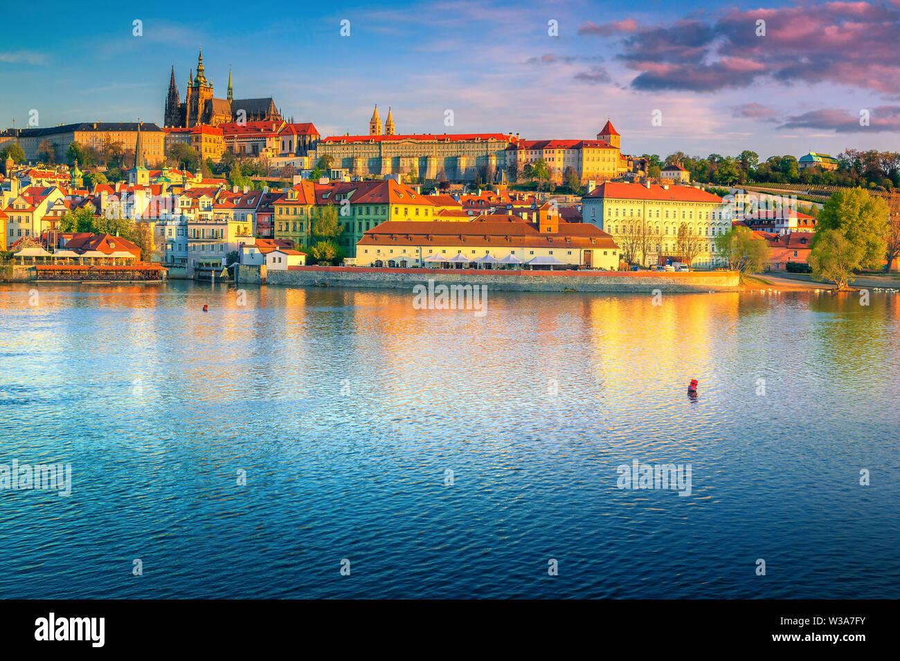 Popular travel and touristic destination. Fantastic Prague castle with famous medieval church at colorful sunrise, Prague cityscape, Czech Republic, E - Stock Image