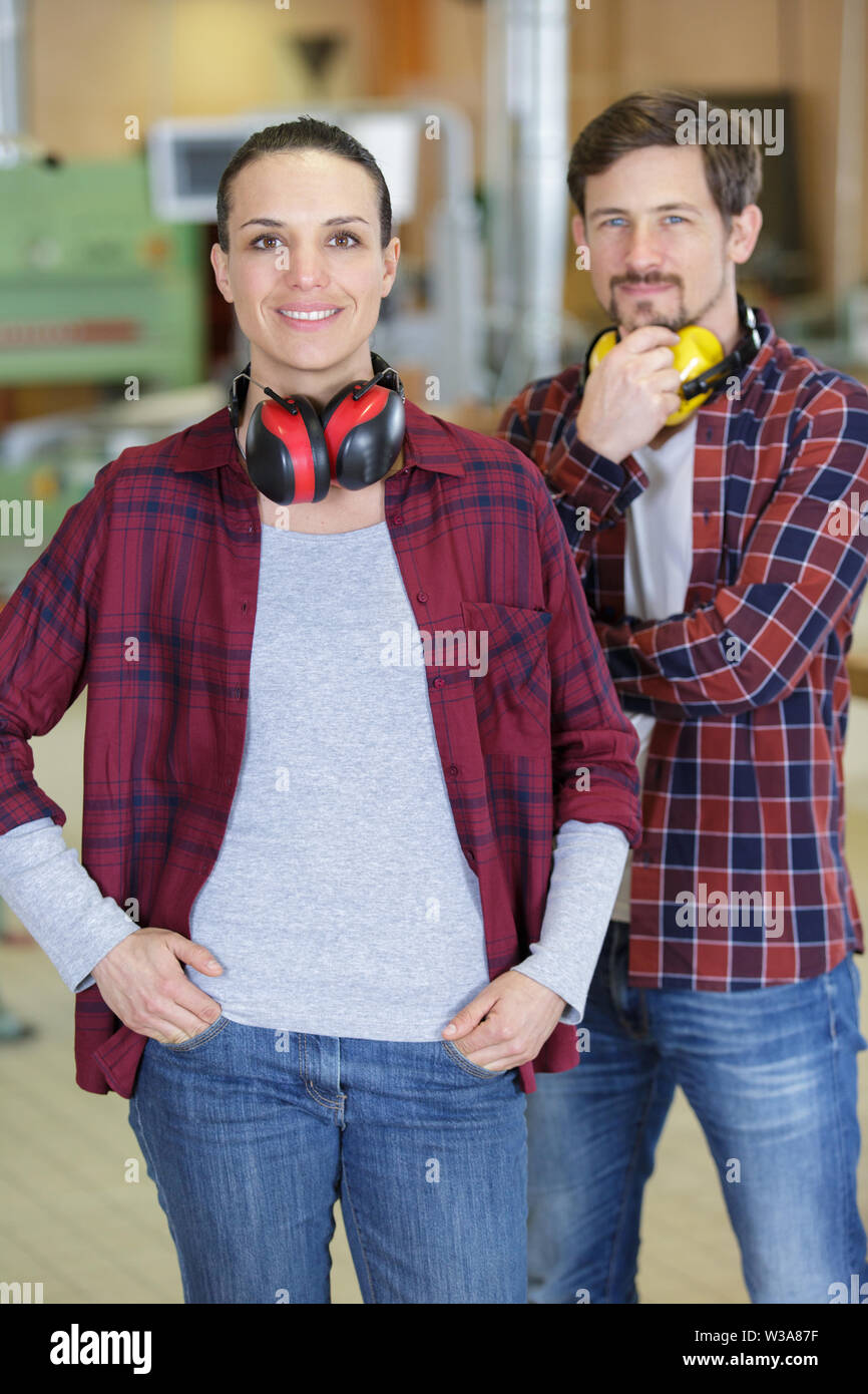 man and woman workers in carpentry workshop - Stock Image