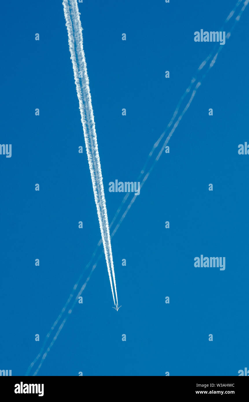 Jet aircraft in the sky against blue sky in Europe, Germany - Stock Image