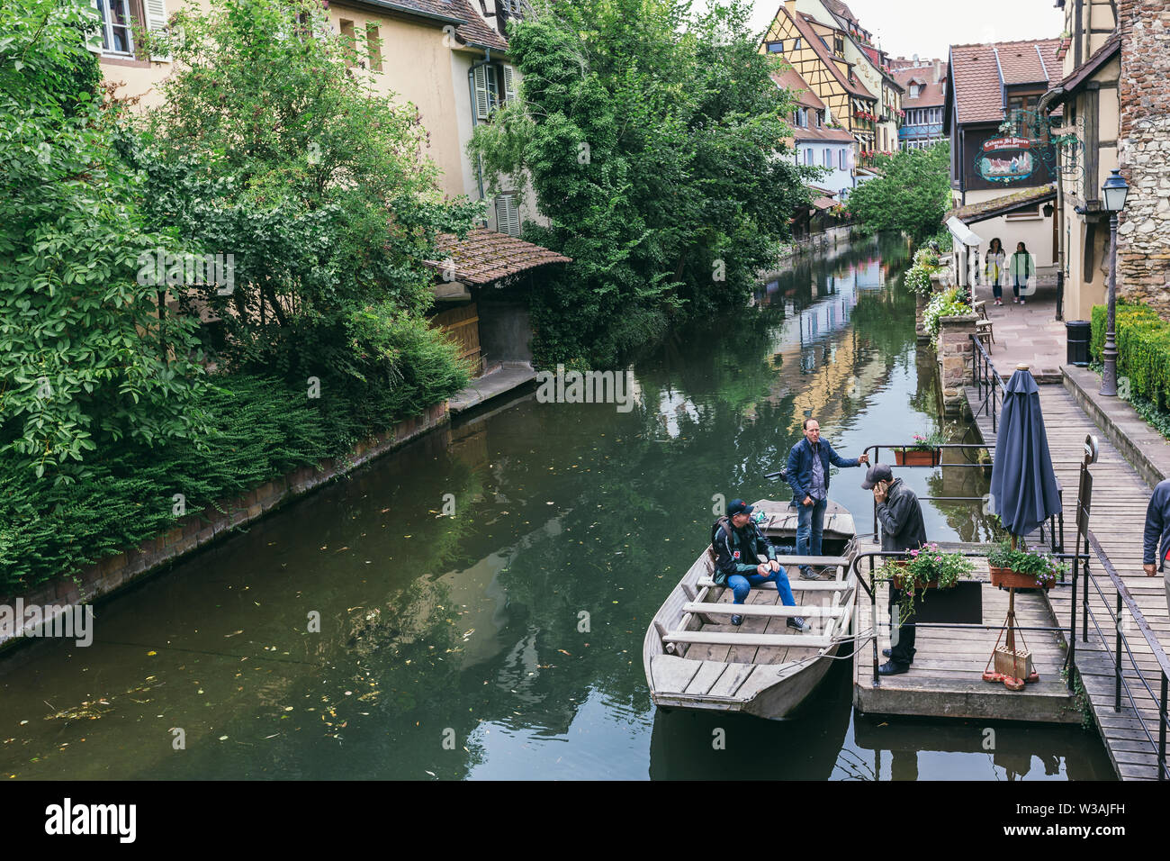 Colmar, France - July 26, 2017. picturesque water channel along the old houses in Colmar, Alsace - Stock Image