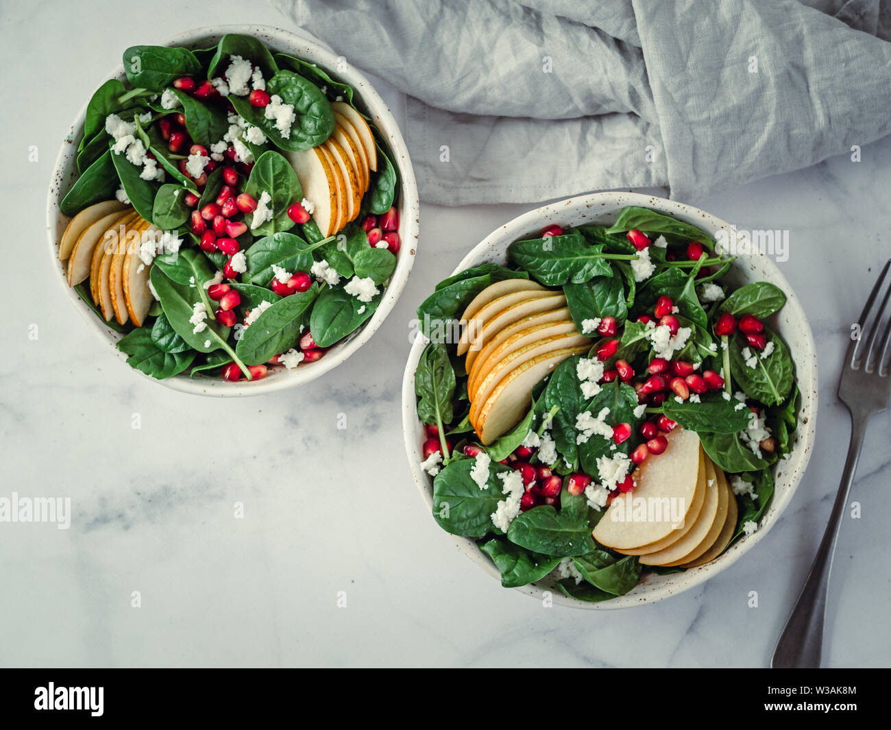 Fresh Salad With Baby Spinach Pear Pomegranate And Cottage Cheese Two Bowls With Delicious Summer Fruit Salad On Marble Table Copy Space For Text Ideas And Recipes For Healthy Breakfast Or Lunch