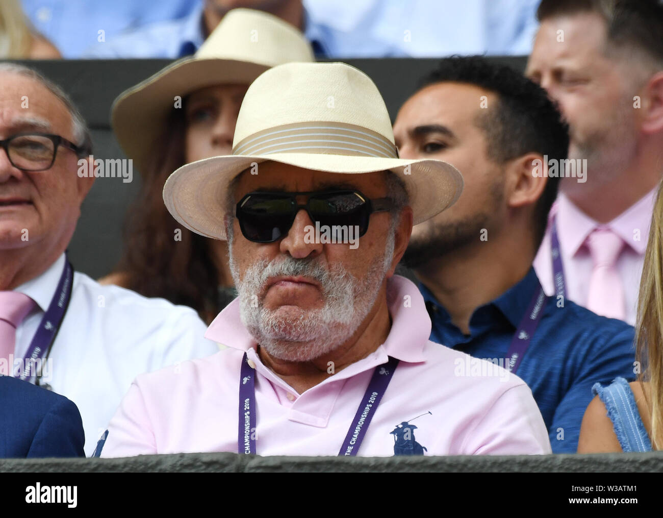 "London, UK. 13 July 2019 The Championships Wimbledon 2019 13072019 Billionaire Romanian  Entrepreneur Ion Tiriac, also known as the ""Brasov Bulldozer""  watches compatriot Simona Halep  celebrates as she wins Ladies Singles Final. Credit: Roger Parker/Alamy Live News - Stock Image"