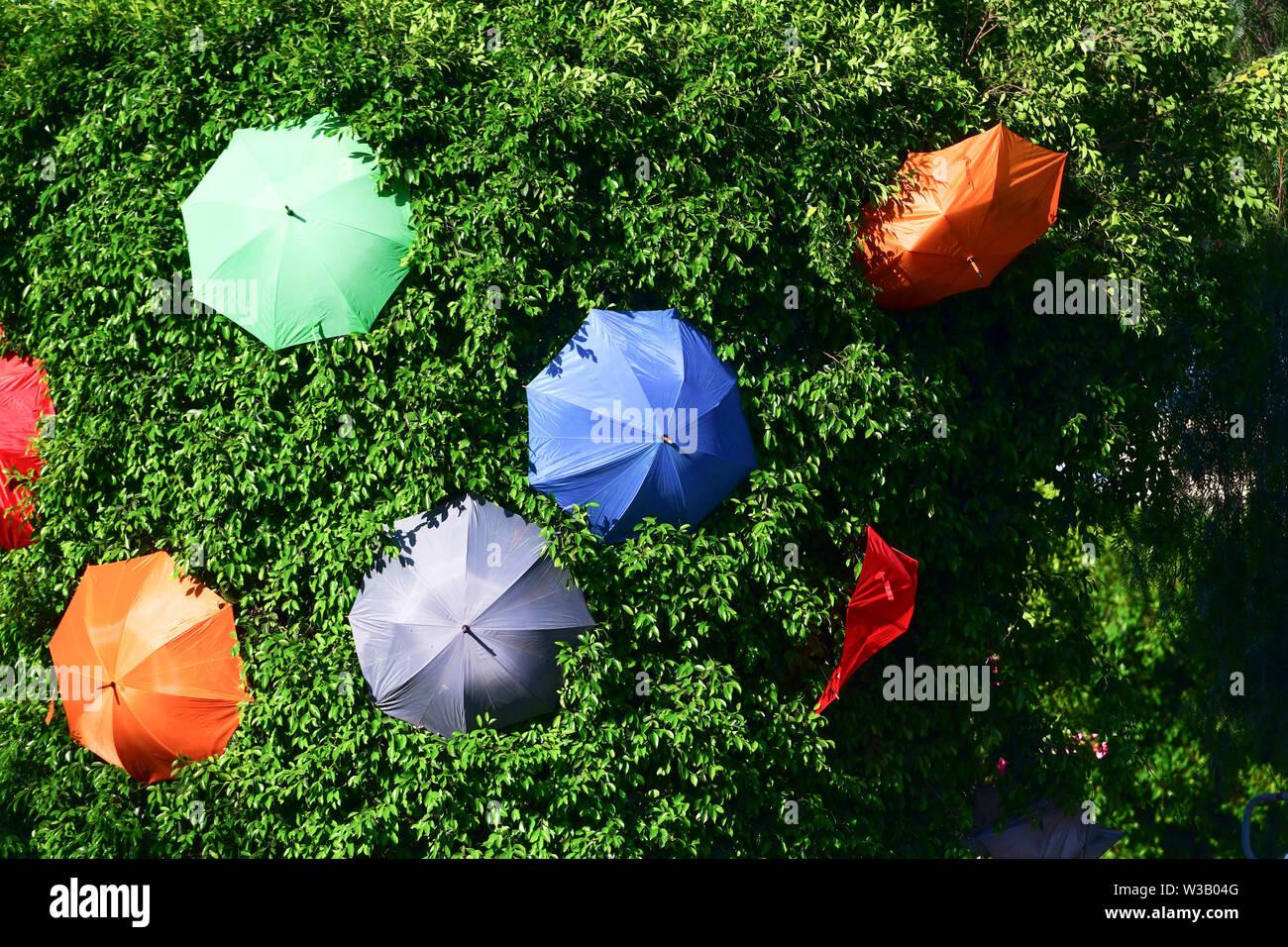 Zabbar. 13th July, 2019. Photo taken on July 13, 2019 shows umbrellas along a street to bring back the popular 'Umbrella Street' spectacle in Zabbar, Malta. Credit: Jonathan Borg/Xinhua/Alamy Live News - Stock Image