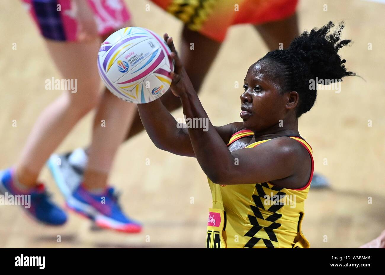 Liverpool, UK. 14 July 2019. Ruth Meeme (Uganda) during the Preliminary game between Uganda and Scotland at the Netball World Cup. M and S arena, Liverpool. Merseyside. UK. Credit Garry Bowdenh/SIP photo agency/Alamy live news. Stock Photo