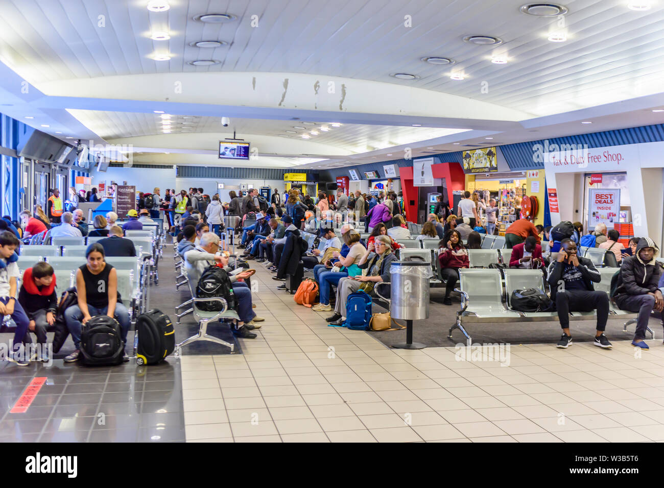 Departure lounge inside the very small and busy Hosea Kutako International Airport, Windhoek, Namibia - Stock Image