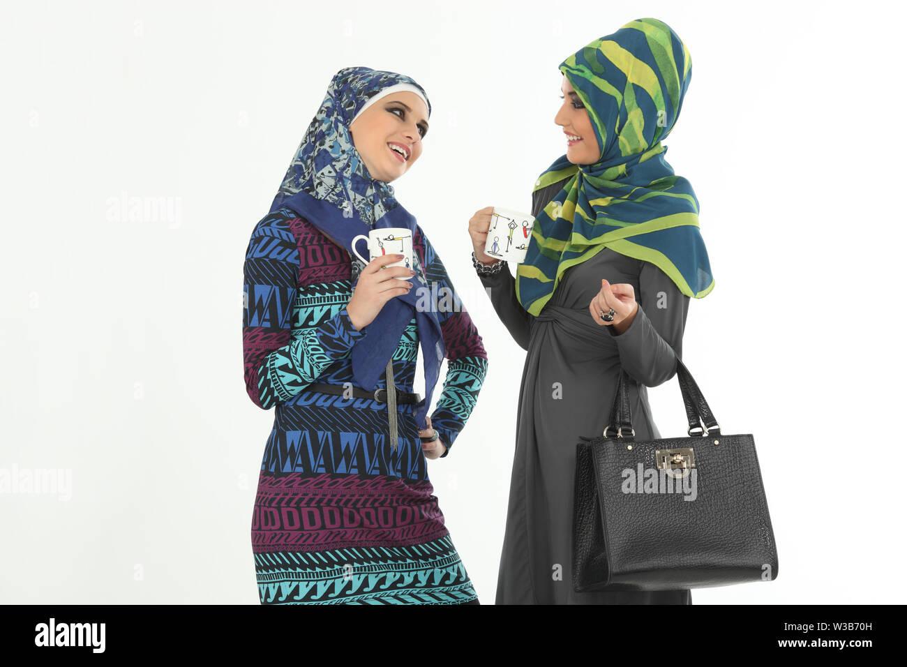 Two women talking and having tea Stock Photo