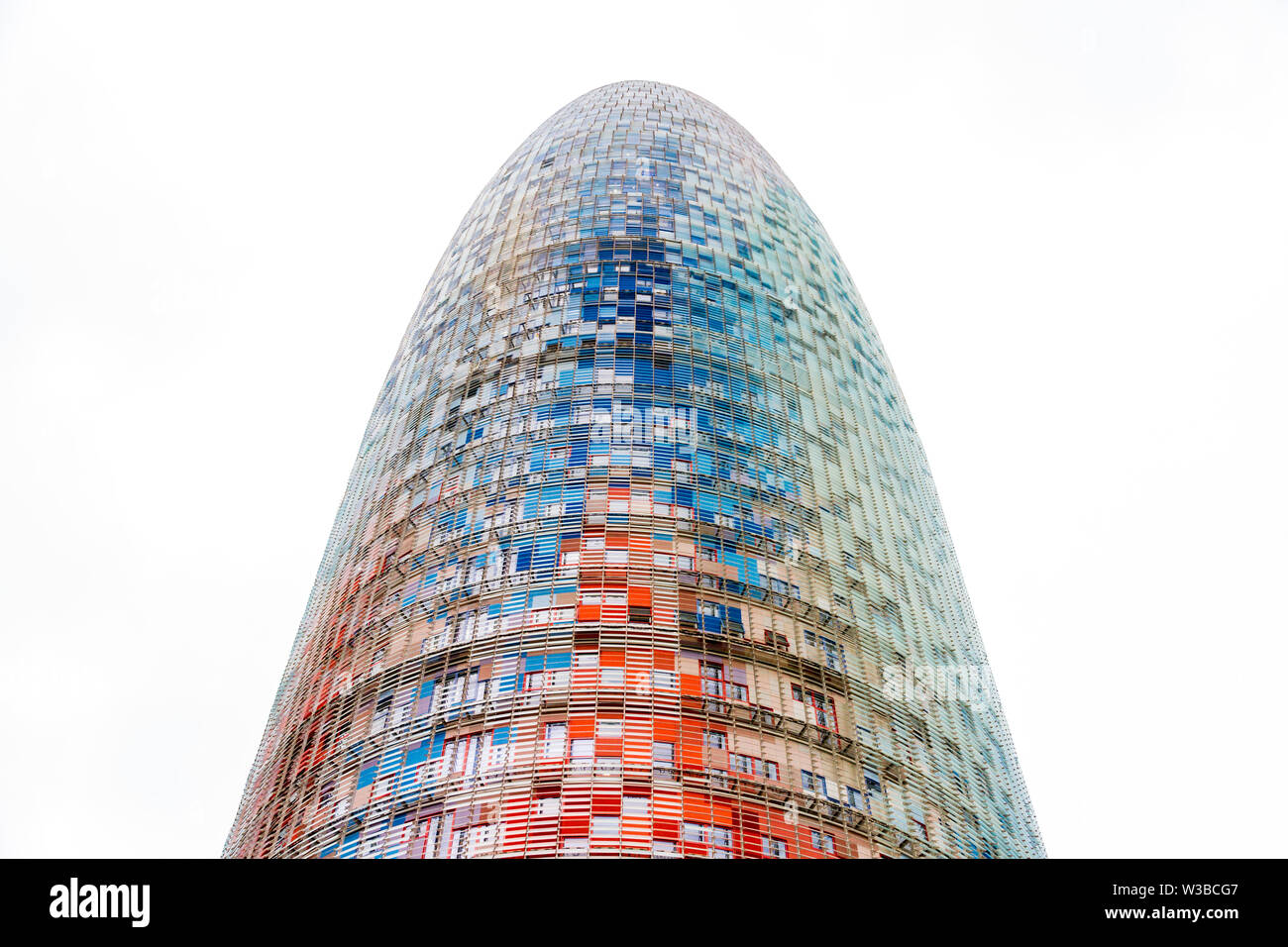 Barcelona, Spain - September 05, 2018: The Torre Glories, formerly known as Torre Agbar in a beautiful autumn light in Barcelona, Spain - Stock Image