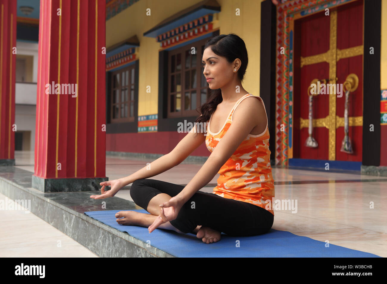 Indian Woman Practicing Yoga In A Monastery New Delhi India Stock Photo Alamy