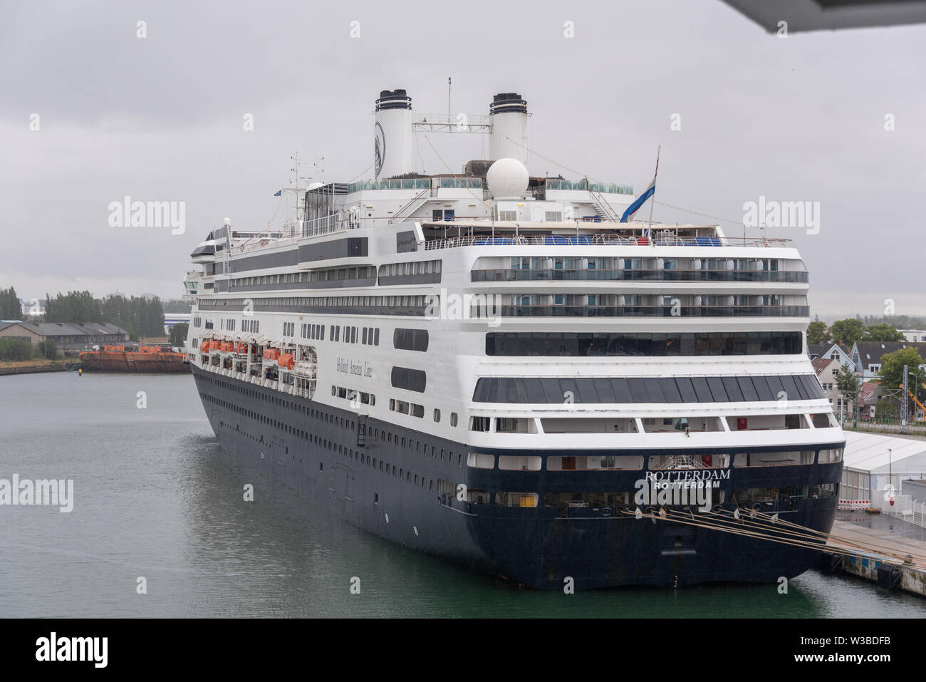 Rostock, Germany - July 7, 2019: View of the cruise liner Rotterdam in the port of Rostock, Germany. - Stock Image