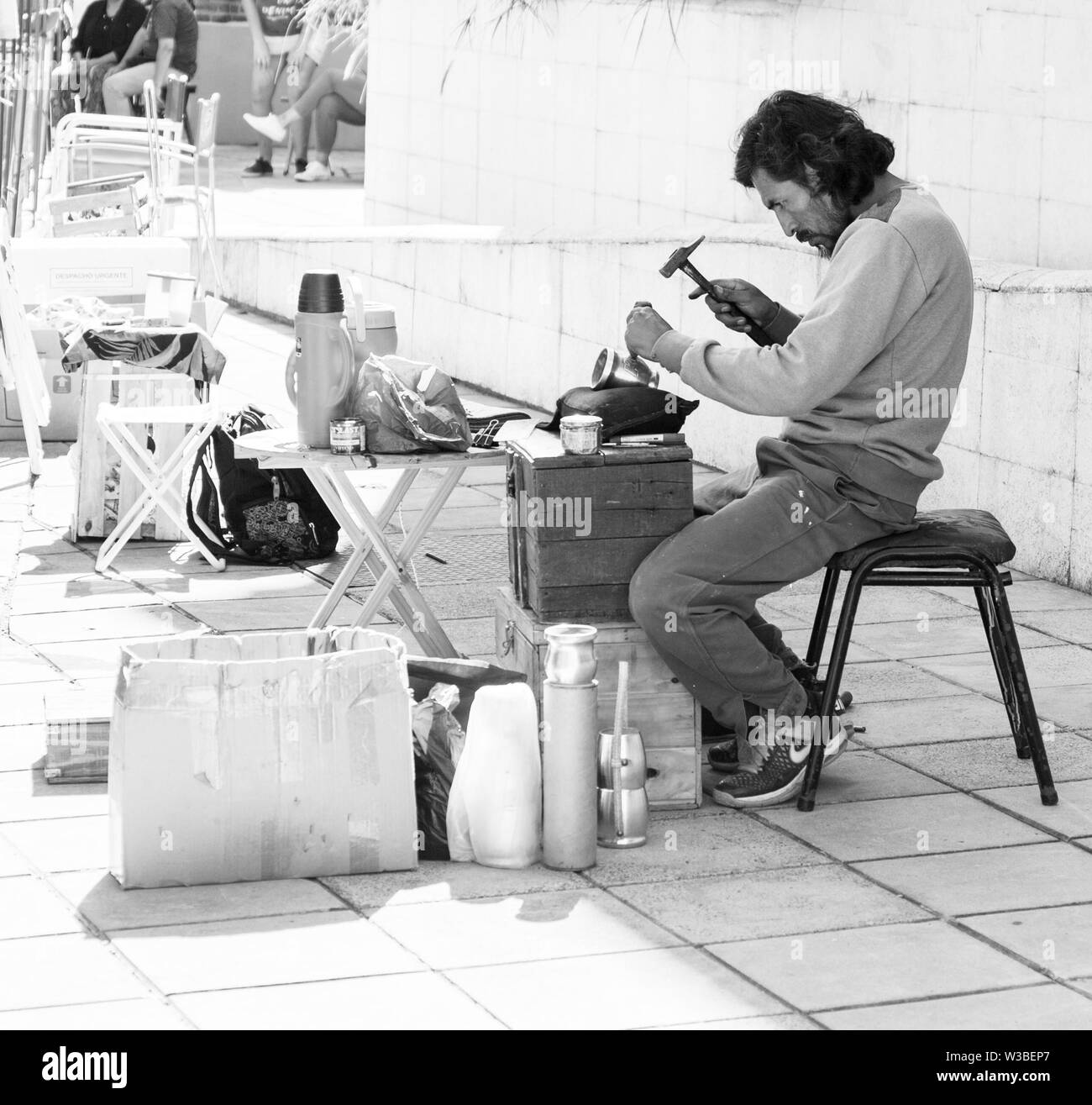 Buenos Aires, Argentina. July 14, 2019. Street craftsman, engraver. Engraves the inscriptions on the vessels for mate tea. Stock photo - Stock Image