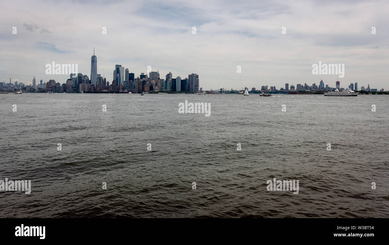 Skyline and modern office buildings of Midtown Manhattan viewed from across the Hudson River. - Image - Stock Image