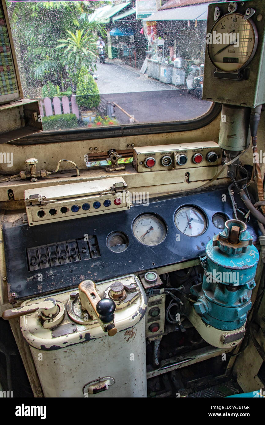 The train driver's cab in the old train standing at railway station. The empty interior of retro locomotive with driver cabin. - Stock Image