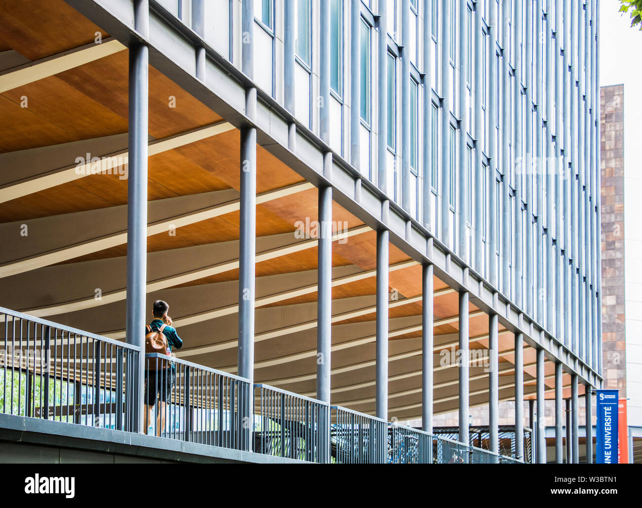 Paris, France - July 8, 2019: Student on phone at Sorbonne University campus in Paris, France - Stock Image