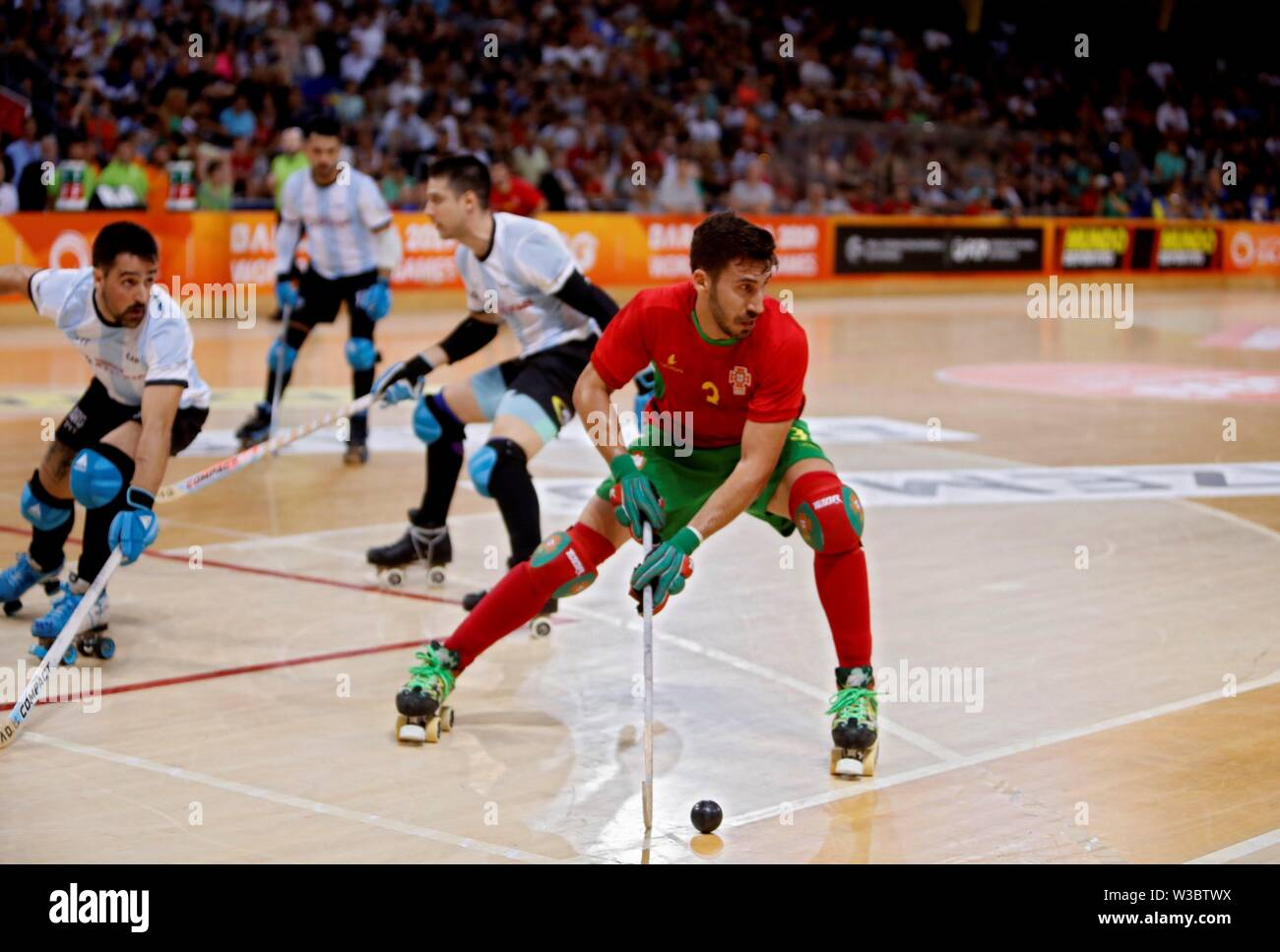 Barcelona, Spain. 14th July, 2019. Portuguese National Roller Hockey Team's player Jose Rafael Costa (C) controls the ball against Argentina during men's roller hockey third-place play-off as part of World Roller Games in Barcelona, Spain, 14 July 2019. Credit: Toni Albir/EFE/Alamy Live News - Stock Image