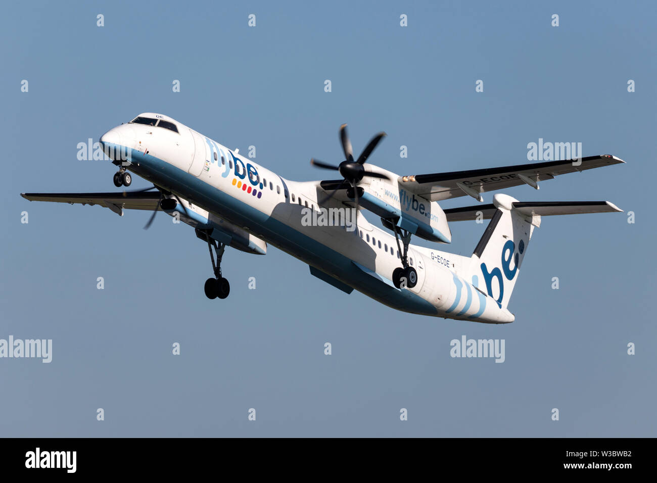 British flybe Bombardier DHC-8-400 Dash 8 with registration G-ECOE just airborne at Amsterdam Airport Schiphol. - Stock Image