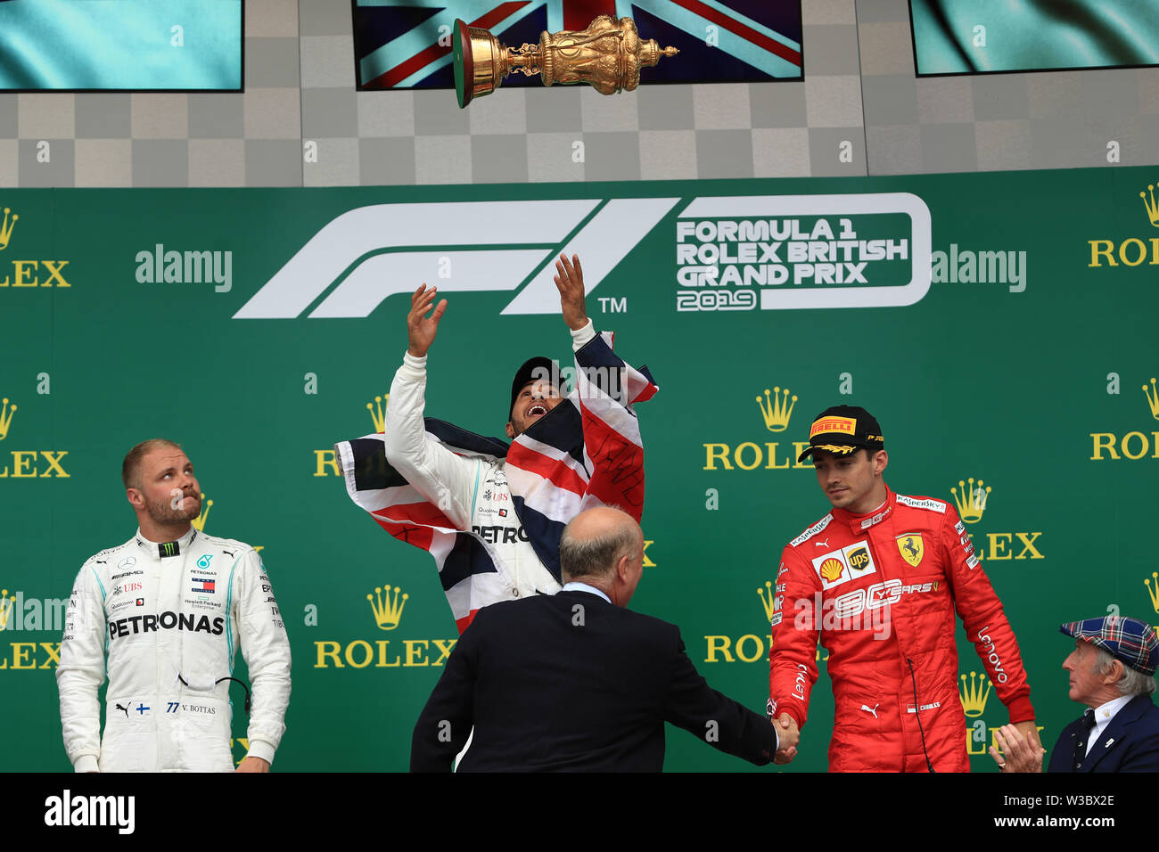 Silverstone, UK. 14th July 2019. FIA F1 Grand Prix of Britain, Race Day; Mercedes AMG Petronas Motorsport, Lewis Hamilton wins the British GP followed by team mate Valtteri Bottas and Scuderia Ferrari, Charles Leclerc Credit: Action Plus Sports Images/Alamy Live News Stock Photo