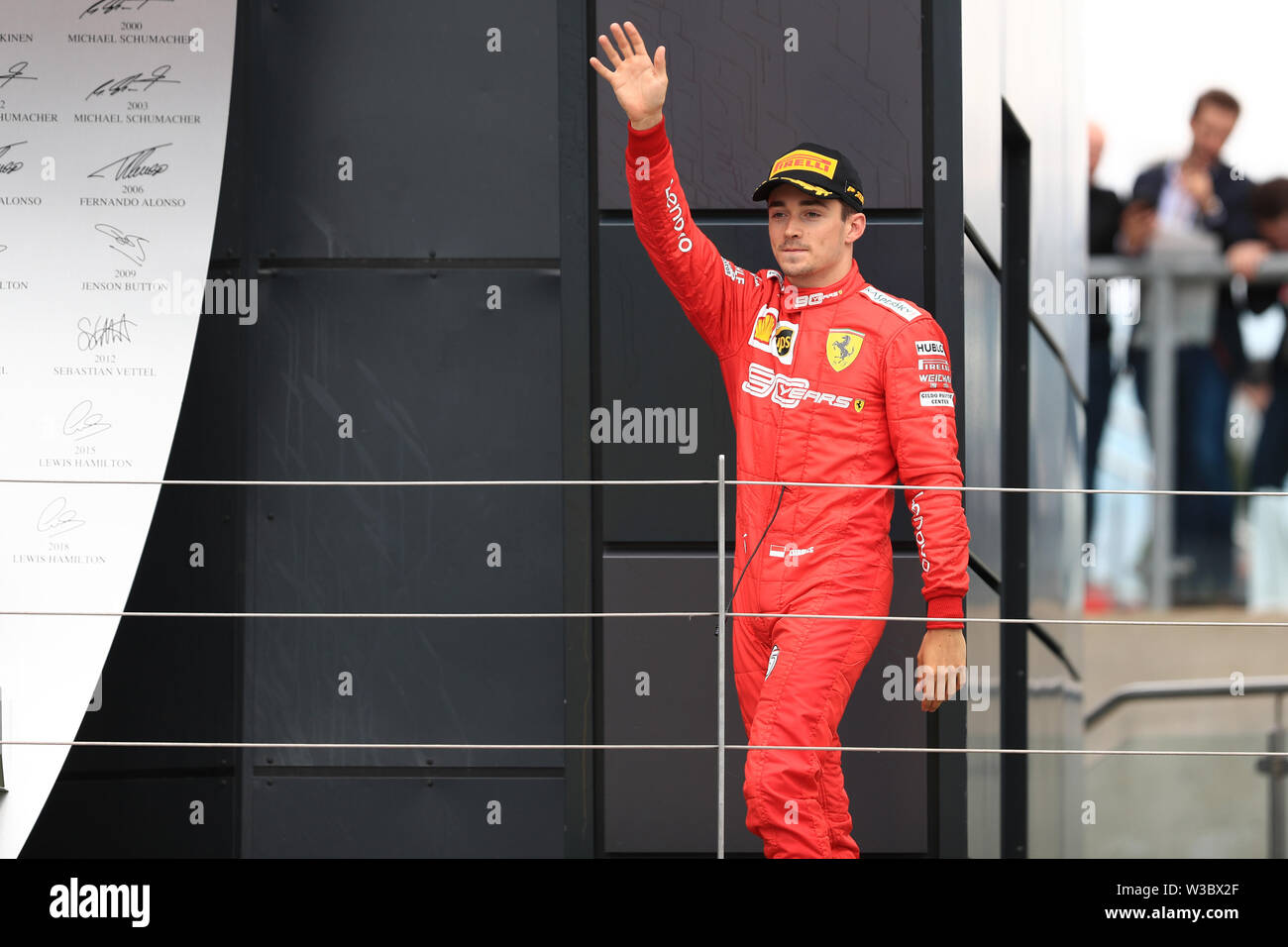 Silverstone, UK. 14th July 2019. FIA F1 Grand Prix of Britain, Race Day; Scuderia Ferrari, Charles Leclerc on the podium Credit: Action Plus Sports Images/Alamy Live News Stock Photo