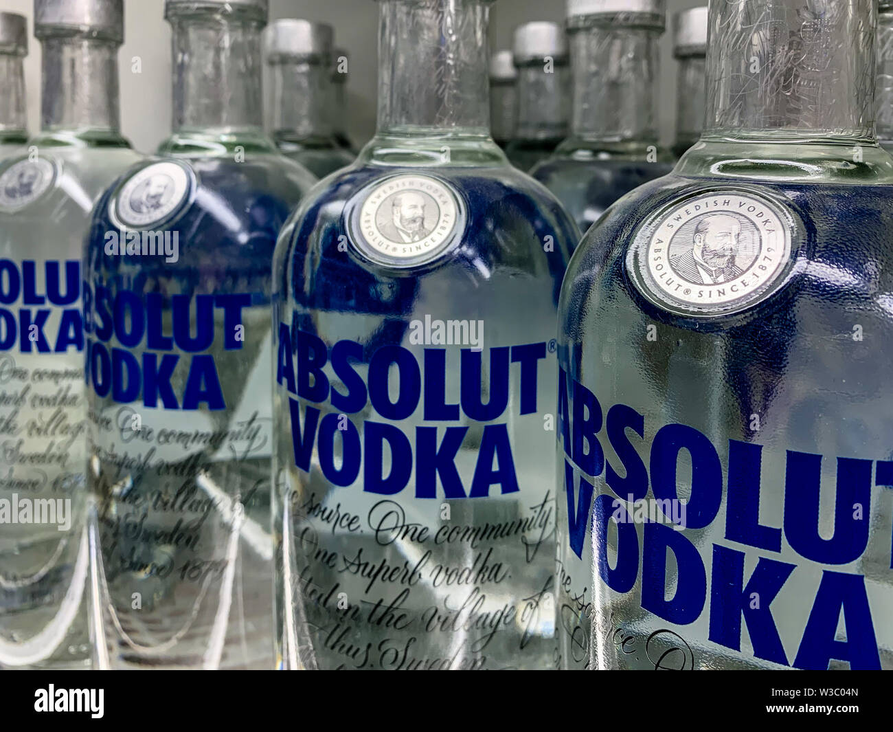 Vodka bottles on a shelf in a store  Absolut Vodka is a