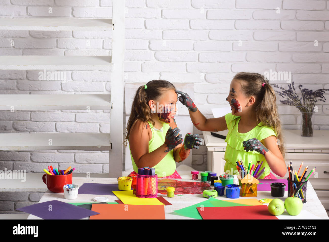 Children Artists With Painted Hands Girls Drawing On Face Skin With Paints Body Art And Painting Kids Learning And Playing Imagination Creativity Stock Photo Alamy