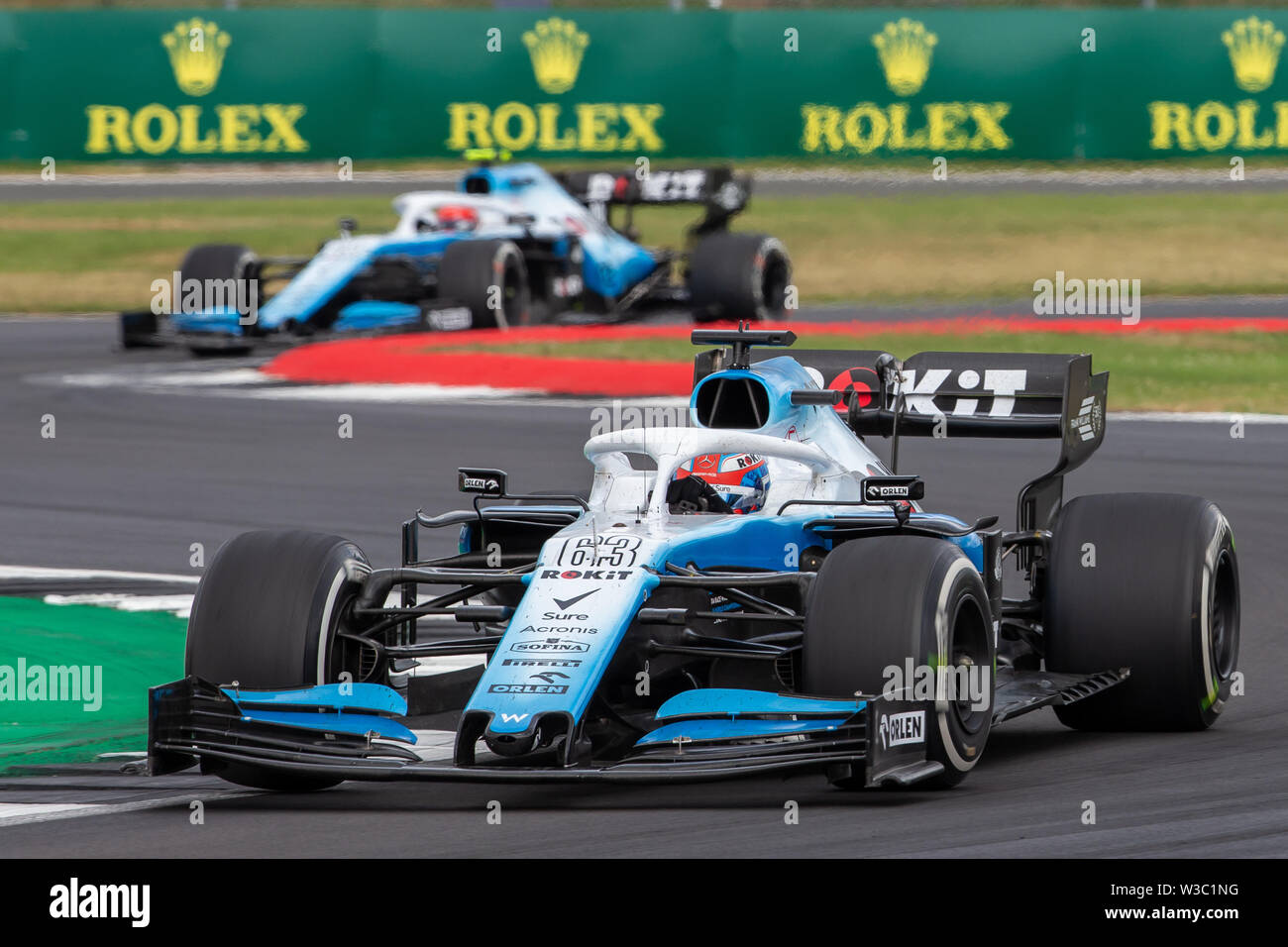 Silverstone, UK. 14th July 2019. FIA F1 Grand Prix of Britain, Race Day; ROKiT Williams Racing team mates, George Russell and Robert Kubica Credit: Action Plus Sports Images/Alamy Live News Stock Photo