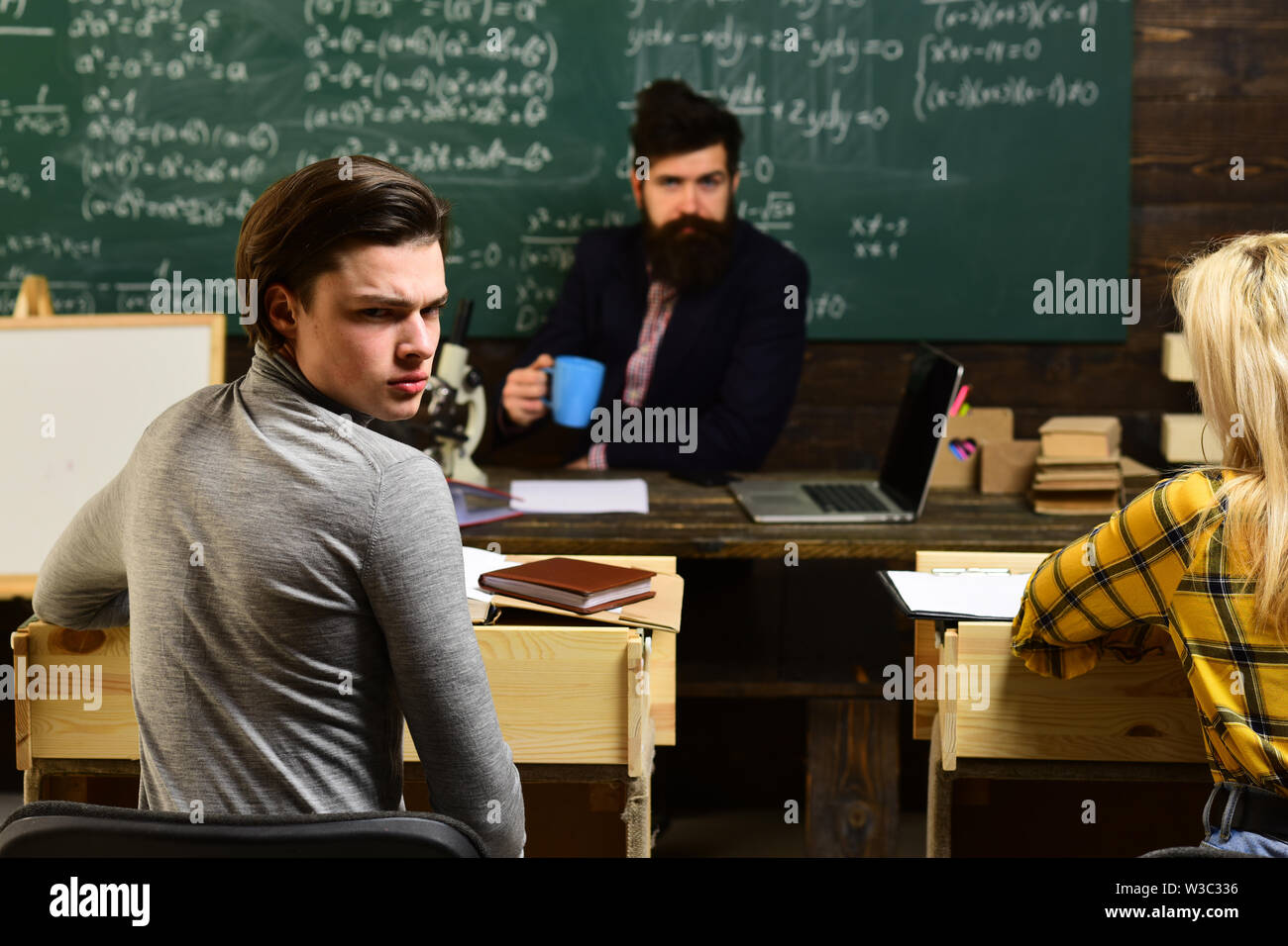 Be cool and you will be able to attract and retain lot more students. ollaboration with teacher is beneficial to the success of student - Stock Image