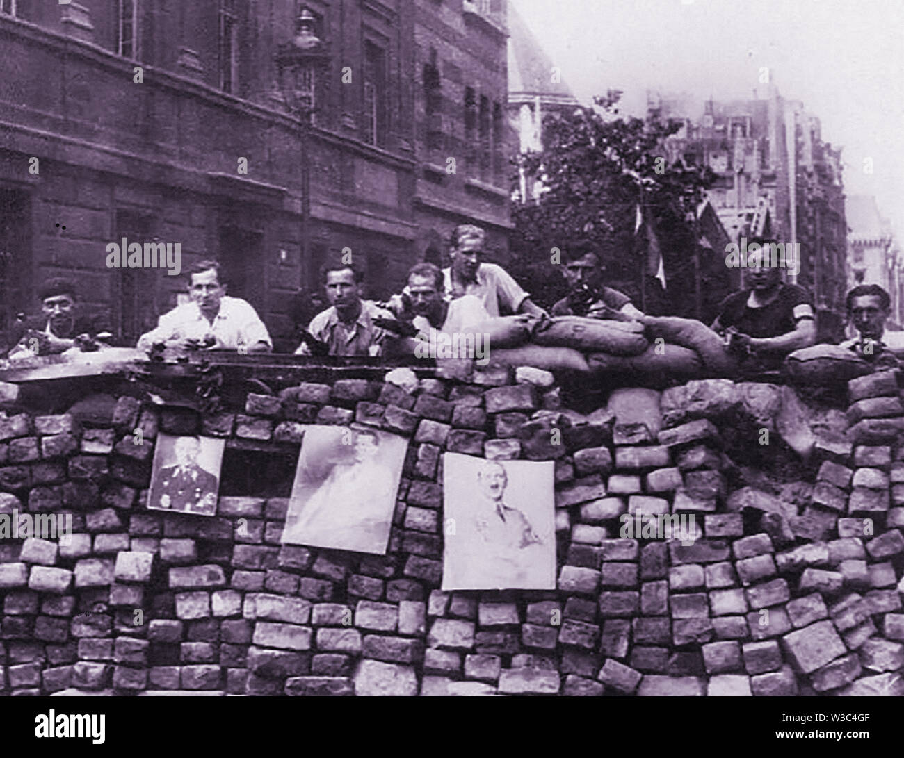 WWII printed old photograph of members of the  French resistance movement manning a barricade in Paris. - Stock Image