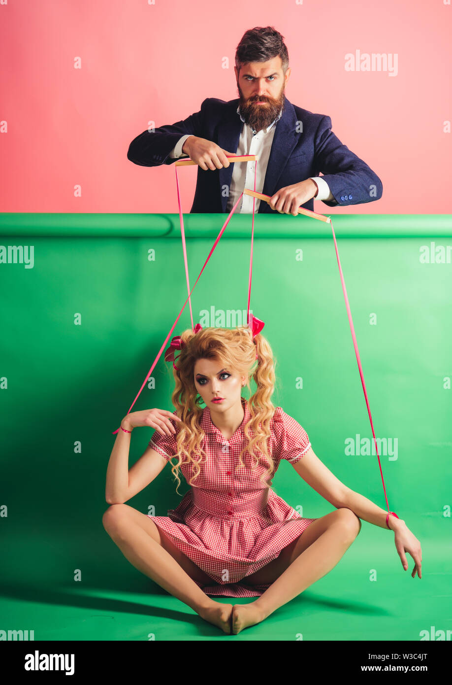 retro girl and master in party. vintage fashion woman puppet and man. Creative idea. Love. Crazy girs and man on pink. Halloween. holidays and doll. d - Stock Image